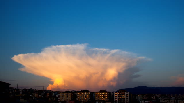 Cumulonimbus Capillatus clouds with some cumulus clouds while getting dark and sun going down. Cumulonimbus Capillatus clouds with some cumulus clouds while getting dark and sun going down. anvil stock videos & royalty-free footage