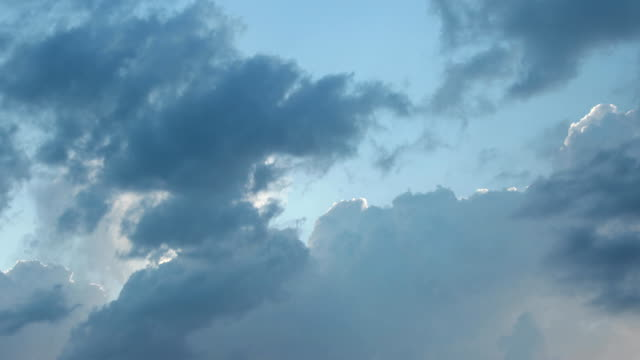cumulus clouds with shining edges in the sun
