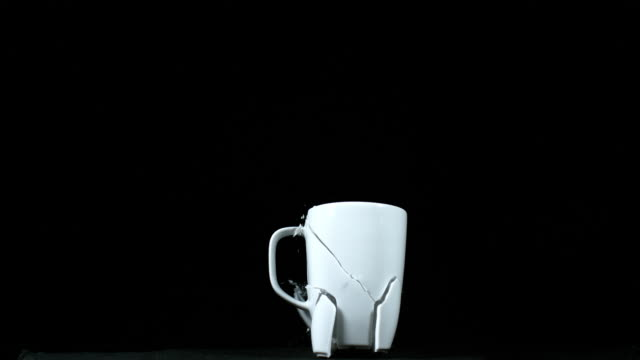 cup falling and exploding on black background, slow motion 4k - cup stock videos & royalty-free footage