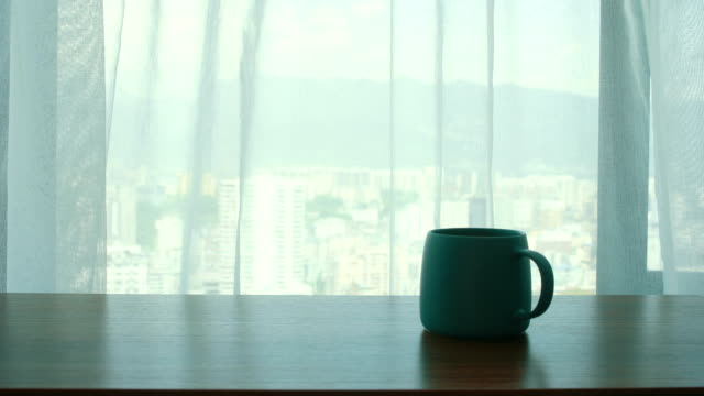 stockvideo's en b-roll-footage met kopje koffie op de tafel door het gordijn - photography curtains
