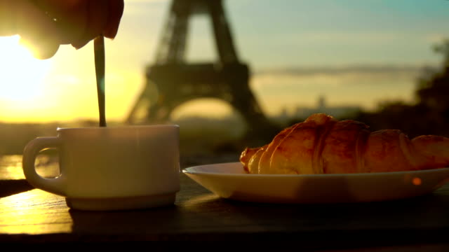 cup of coffee with a croissant in paris - кафе стоковые видео и кадры b-roll