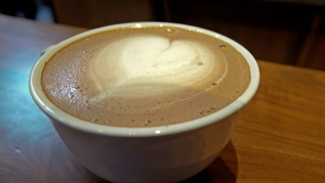 Cup Of Coffee with simple Latte art Close up video