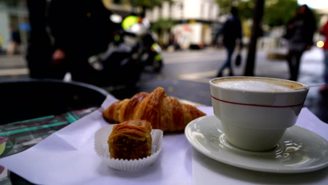 cup of fresh hot coffee and traditional french croissant - parigi video stock e b–roll