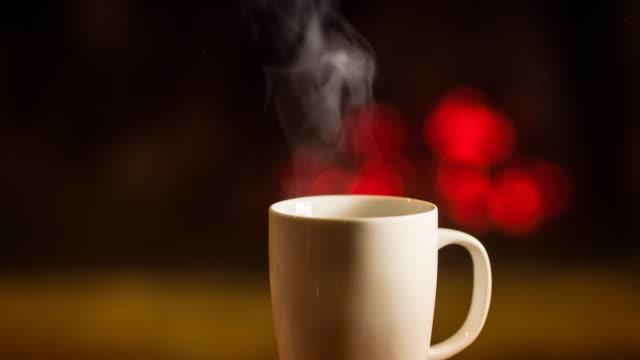 vídeos de stock, filmes e b-roll de bebida quente em frente à lareira - tea drinks