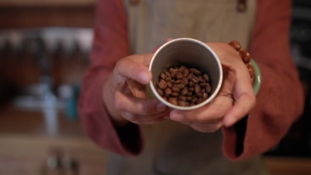 Cup with fresh roasted coffee beans