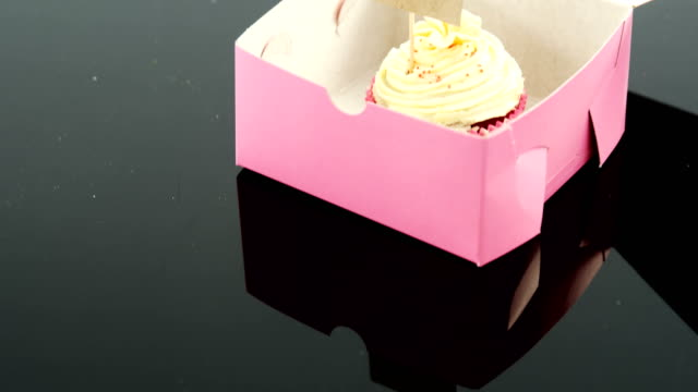 Cupcake with happy mother day card against black background video