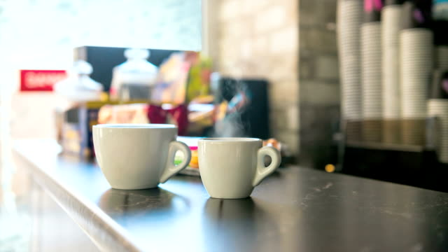 cups of hot coffee on a bar counter