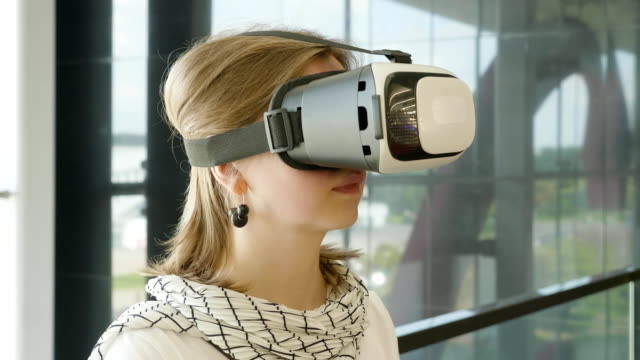 curious amazed woman trying augmented reality glasses, feeling excited about vr headset simulation, exploring virtual life by gesturing hands to touch 3d world, having fun with goggles. - ritratto 360 gradi video stock e b–roll