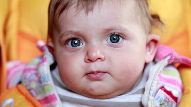 Curious baby stares at camera video