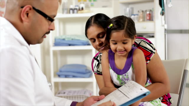 curious little girl asks doctor about her chart video