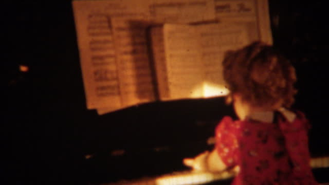 1940: curly haired girl shirley temple clone playing piano. - classical architecture stock videos & royalty-free footage