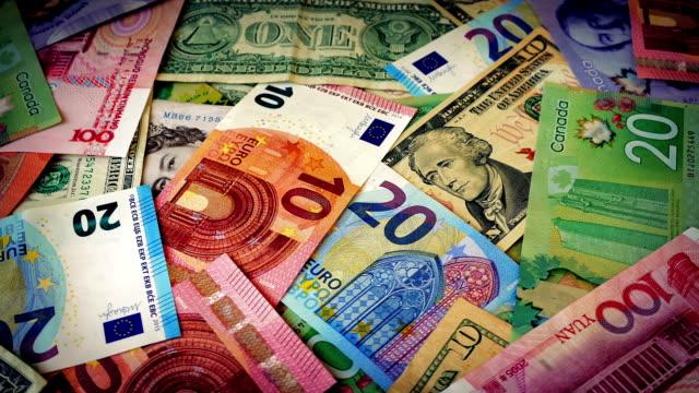 valuta del mondo di luce rotante - simbolo finanziario video stock e b–roll