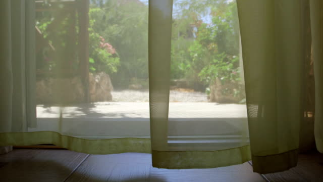 DOLLY: Curtains fluttering in the breeze video