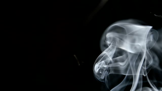 SLOW MOTION: Curve smoke lifts up on a dark background video