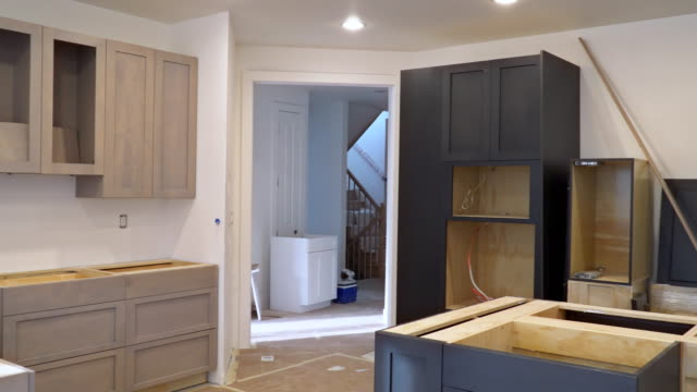 Custom kitchen cabinets in various stages of installation base for Installation of kitchen cabinets Custom kitchen cabinets in various stages of installation base for Installation of kitchen cabinets renovation stock videos & royalty-free footage