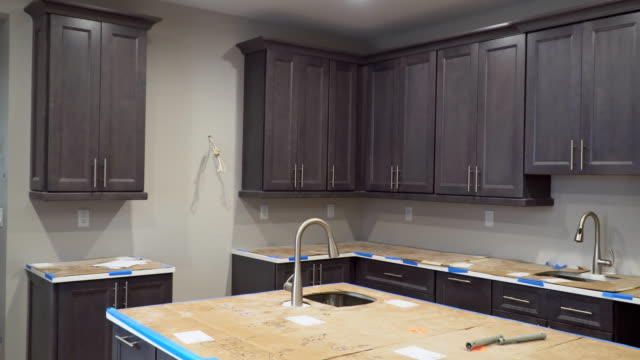 Custom kitchen cabinets in various stages of installation base for Installation of kitchen cabinets Custom kitchen cabinets in various stages of installation base for Installation of kitchen cabinets cabinet stock videos & royalty-free footage