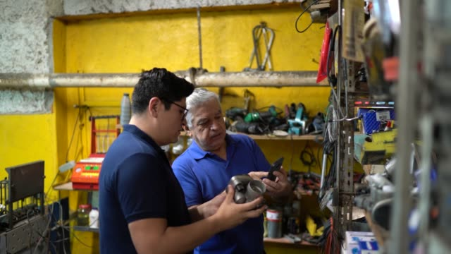 Customer and people working at repair shop