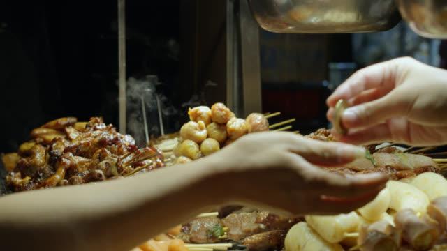 Customer Buying Meat Skewers at Raohe Night Market