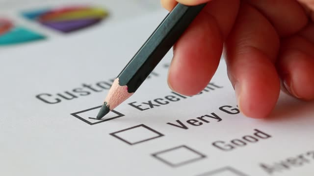Customer checklist survey form for feedback satisfaction mark over application blue forms report graph index document with black pencil. Opinion question circle botton for filling checkmark  business