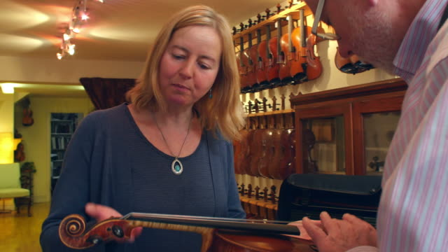 Customer Collecting Violin From Shop After Repair video