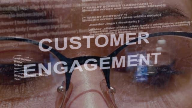 Customer engagement text on background of female developer