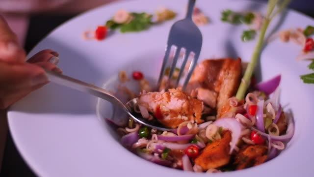 Customer having Thai spicy grilled salmon salad. Customer having Thai spicy grilled salmon salad. menu stock videos & royalty-free footage