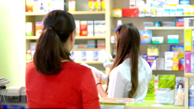 Customer in a drugstore buying some medication video