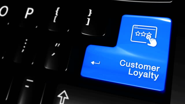 customer loyalty moving motion on computer keyboard button. - fedeltà video stock e b–roll