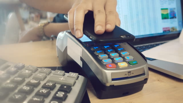 Customer making contactless payment with smart phone