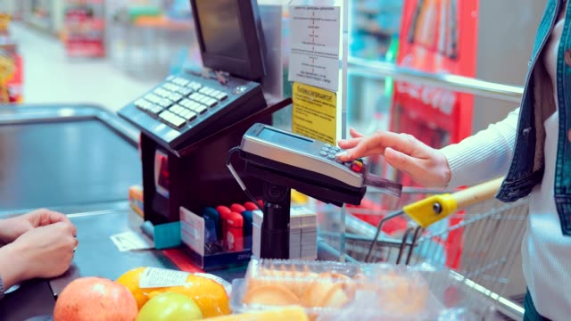 Customer paying buy credit card at grocery store or supermarket. Close-up Customer paying buy credit card at grocery store or supermarket. Close-up register stock videos & royalty-free footage