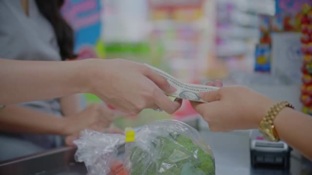 SLO MO Customer paying cash for goods with the cashier,Close-up SLO MO Customer paying cash for goods with the cashier,Close-up paper currency stock videos & royalty-free footage