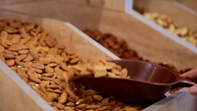 Customer purchases almond in grocery video