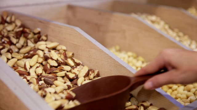 Customer purchases Brazil nuts in grocery video
