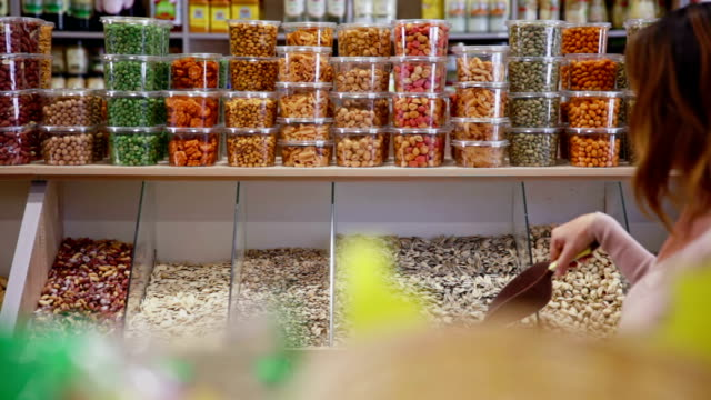 Customer purchases seeds in grocery video