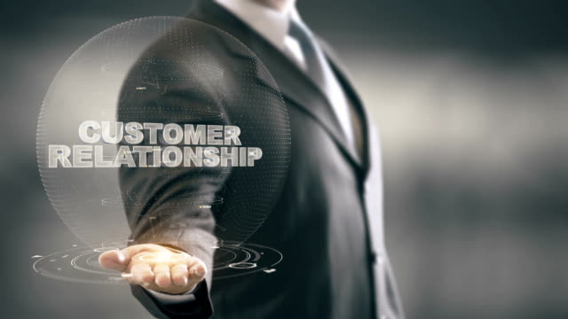 customer relationship businessman holding in hand new technologies - fedeltà video stock e b–roll