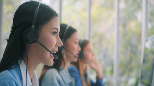 Customer service representative working with colleagues,Slow motion 4K DCI Customer service representative working with colleagues,Slow motion 4K DCI employee engagement stock videos & royalty-free footage
