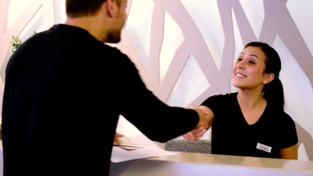 customer service - receptionist stock videos and b-roll footage
