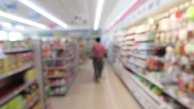 Customer shopping in supermarket convenience store  aisle interior shelves blur background Customer shopping in supermarket convenience store  aisle interior shelves blur background snack aisle stock videos & royalty-free footage