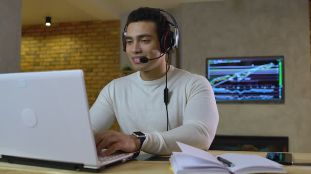 Customer support manager working at home, talking to client by headset, career