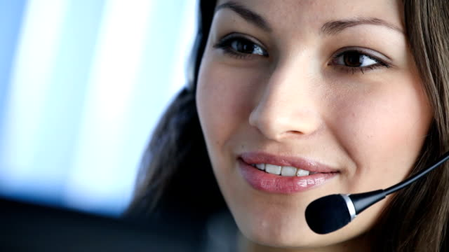 hd: customer support phone operator at workplace - call center stock videos and b-roll footage