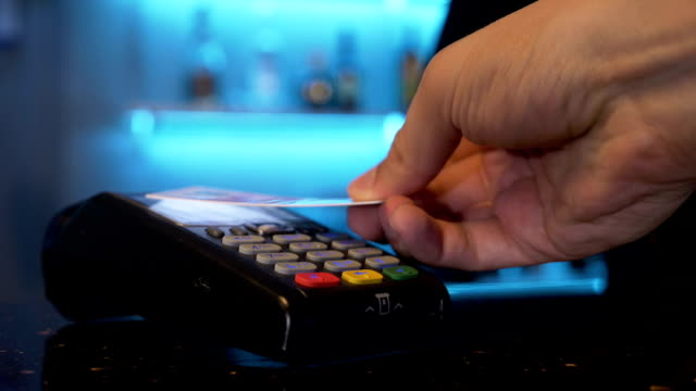 Customer using credit card over pos module for cashless contactless payment for shopping Customer using credit card over pos module for cashless contactless payment for shopping credit card purchase stock videos & royalty-free footage