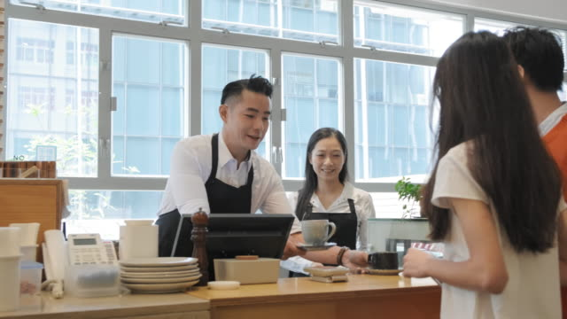 Customers at Point of Sale Counter Purchasing Coffee Drink video