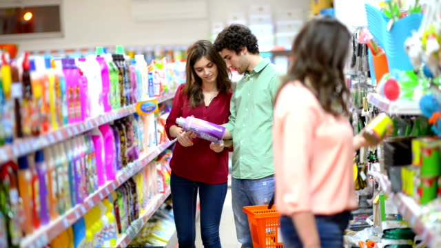 customers choosing cleaning products in supermarket - disinfectant stock videos & royalty-free footage