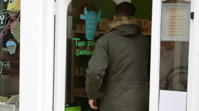 customers entering and leaving cafe shot on r3d - entrare video stock e b–roll