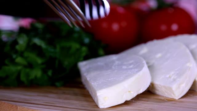 cut cheese on plate, breakfast dish - formaggio spalmabile video stock e b–roll