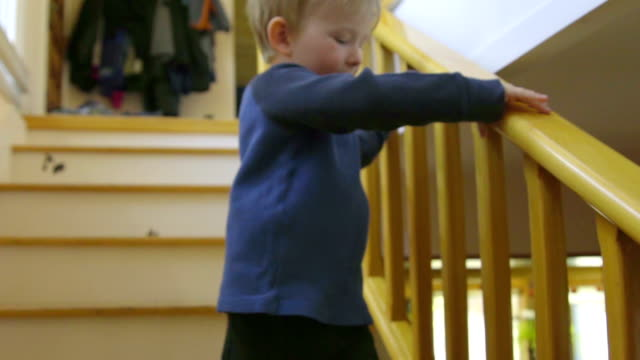 Cut child runs down some house steps video