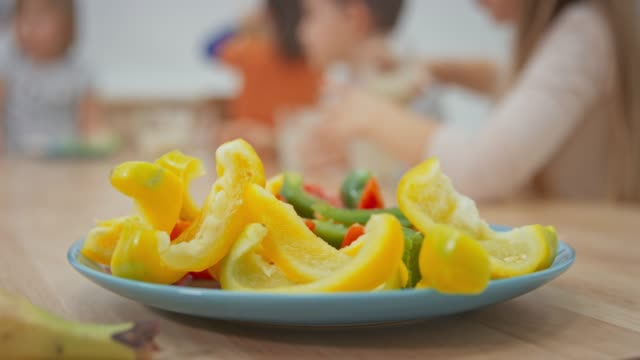 Cut colorful peppers set on the table at school at snack time