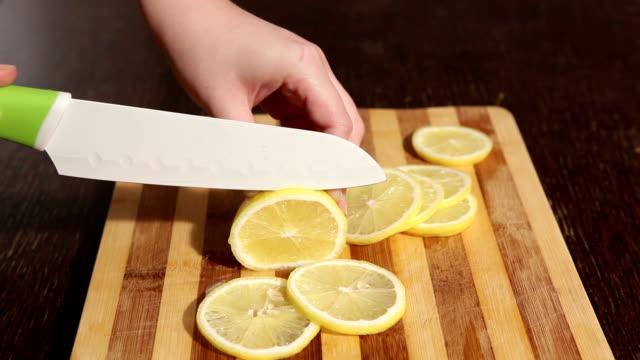 Cut lemon on cutting board video