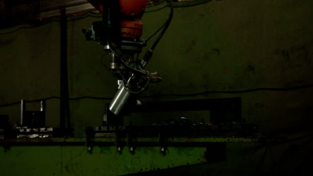 Cut sheet metal with sparks. Modern tool in heavy industry. Dangerous job. Automation process indoors. video