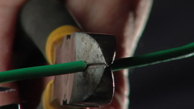 Cut the Wire HD 720p30 Cutting the green wire. Close up. 3 different views.  cutting stock videos & royalty-free footage